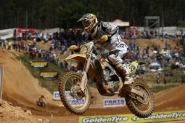 Desalle Recovers From Crash to Spray the Champagne
